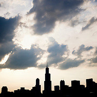 Photo of Chicago skyline silhouette with Willis Tower (Sears Tower) and other  downtown Chicago buildings. Picture is high resolution and was taken in 2010.