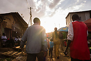 Kibera residents walk into the afternoon sun, fashion and beauty can be seen in the diverse communities of  Nairobi, Kenya on Sunday 15th of September.