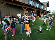 PRICE CHAMBERS / NEWS&amp;GUIDE<br /> Shooting Star hosts a pig roast with Habitat for Humanity on Thursday, taking time to celebrate the Teton Village delvelopment that includes free market homes and some built by Habitat volunteers.