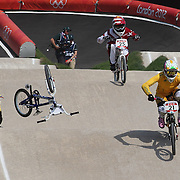 Lauren Reynolds, Australia, (right) in action as Stefany Hernandez, Venezuela, (left) falls during the Cycling BMX Finals Day during the London 2012 Olympic games. London, UK. 10th August 2012. Photo Tim Clayton