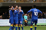 AFC Wimbledon midfielder Chris Whelpdale (11) scores a goal 1-0 and celebrates during the EFL Sky Bet League 1 match between AFC Wimbledon and Bury at the Cherry Red Records Stadium, Kingston, England on 19 November 2016. Photo by Stuart Butcher.
