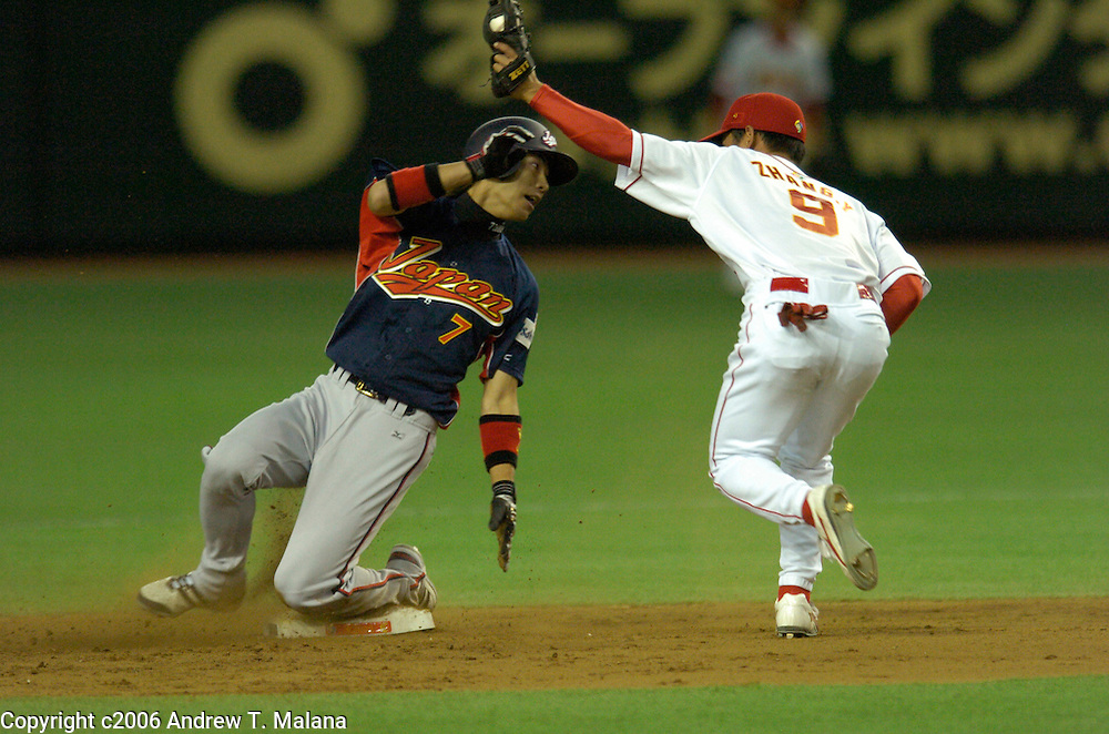 Team Japan's Tsuyoshi Nishioka is caught stealing in the 3rd inning of the second game of the World Baseball Classic at Tokyo Dome, Tokyo, Japan.