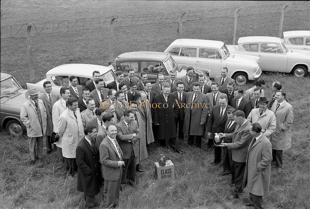 27/05/1962<br /> 05/27/1962<br /> 27 May 1962<br /> Irish Cider and Perry Company Salesmen arrive at Dublin Airport. Forty salesmen flew into Dublin to join the Irish representatives of the Irish Cider and Perry Company in launching the new Irish produced Babycham and Coates' vintage cider throughout Ireland. Both products were made at the newly acquired Bulmers Ltd. factory at Clonmel. The salmon were to visit 10,200 premises. The party arrived from Bristol on an Aer Lingus Charter plane and were assigned a car each. Picture shows members of the group receiving their directions from Mr John Kelly, General Manager, I.C.P.C.; Mr Edward Dix, General Salesmanager; Mr S.J. Neale and Mr. W.N. Cotter, Sales Manager for Ireland, before setting out.