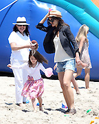 30.MAY.2011. MALIBU<br /> <br /> KATIE HOLMES AND DAUGHTER SURI PLAYING AROUND ON MALIBU BEACH, WITH KATIE RUNNING AFTER SURI IN HER HEEL SANDALS WHILE SURI WAS PLAYING WITH HER BALLOONS.<br /> <br /> BYLINE: EDBIMAGEARCHIVE.COM<br /> <br /> *THIS IMAGE IS STRICTLY FOR UK NEWSPAPERS AND MAGAZINES ONLY*<br /> *FOR WORLD WIDE SALES AND WEB USE PLEASE CONTACT EDBIMAGEARCHIVE - 0208 954 5968*