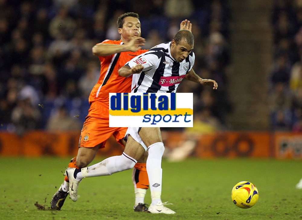 Photo: Rich Eaton.<br /> <br /> West Bromwich Albion v Luton Town. Coca Cola Championship. 12/01/2007. Diomansy  Kamara right of West Brom outpaces Lutons Lewis Emanuel