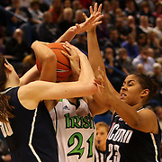 Kayla McBride, Notre Dame, is stopped by Breanna Stewart, Connecticut, (left) and Kaleena Mosqueda-Lewis, Connecticut, (right) during the Connecticut V Notre Dame Final match won by Notre Dame during the Big East Conference, 2013 Women's Basketball Championships at the XL Center, Hartford, Connecticut, USA. 11th March. Photo Tim Clayton