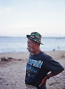 "A portrait of Sunarya, a fisherman cum beach cleanup man. Every day he cleans Mertasari Beach without getting paid or hoping for payment. ""I just can't stand to see the beach dirty, covered in thrash,"" he said. According to a record, around 3,5 million tourists from around the world visited the island for vacation in 2014. Most of them preferred staying in the southern coast such as in Kuta, Nusa Dua, and Sanur. These are the tourism hubs of Bali that naturally attract investors' interest to build hotels and other leisure establishments. The island's tourism is indeed inseparable from its southern coast's history, an area blessed with breathtaking beaches. It is from here the Bali holiday business began to develop as the influx of Australian hippies and surfers to Kuta started back in the 70s. The fishermen's villages would later transform drastically because of it. Hotels, restaurants, and other facilities were growing and spreading along the coast so fast like mushrooms in a rainy season."