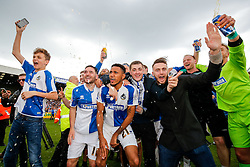 Jake Gosling and Cristian Montano celebrate after Bristol Rovers win the match in injury time to secure 3rd place in League 2, back to back promotions and a place in Sky Bet League 1 for 2016/17 - Mandatory byline: Rogan Thomson/JMP - 08/03/2016 - FOOTBALL - Memorial Stadium - Bristol, England - Bristol Rovers v Dagenham & Redbridge - Sky Bet League 2.