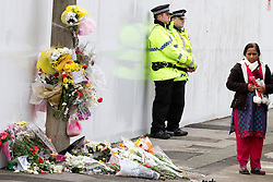 © Licensed to London News Pictures. 06/01/2012. Salford, UK. The mother of Anuj Bidve, who was murdered on Boxing Day in Salford, attends the scene of the crime, where a memorial shrine of flowers, candles and messages has been built. She cried as her husband read a prepared statement to the media, before saying a prayer at the scene. 20 year old Kiaran Stapleton of Regent Square, Ordsall, Salford, has been charged with Mr Bidve's murder. Photo credit : Joel Goodman/LNP
