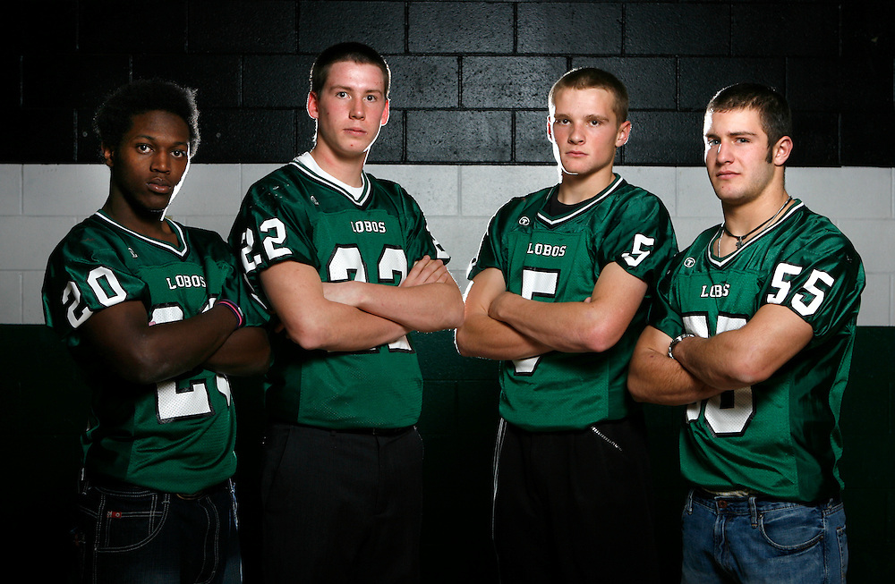 121808-Conifer, Colo.-confootball-Conifer High School's Willie Hayes (No. 20),  Kalvin Winter (No. 22), Mike Vaggalis (No. 5) and Stephen Theiss (No. 55) pose for a portrait Thursday, Dec. 18, 2008 at CHS..Photo By Matthew Jonas/Evergreen Newspapers/Photo Editor