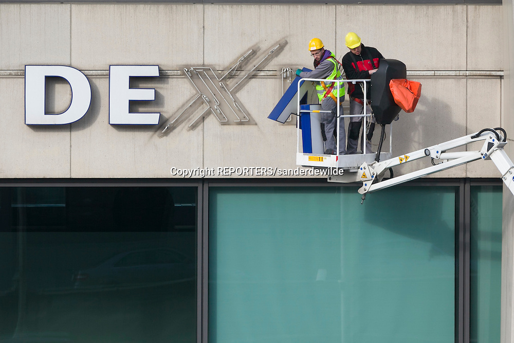 20120228 Brussels, Belgium. Last day Dexia bank Belgium wears its name.The signs are being removed and a new names is chosen the next day. credits REPORTERS/SANDERDEWILDE