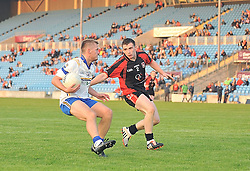 Hollymount Carramore's Conor Keane tries to get past Swinford's Jason Carney during the Intermediate quarter final clash at McHale park.<br /> Pic Conor McKeown