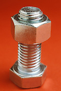 close up of bolt with nut attached
