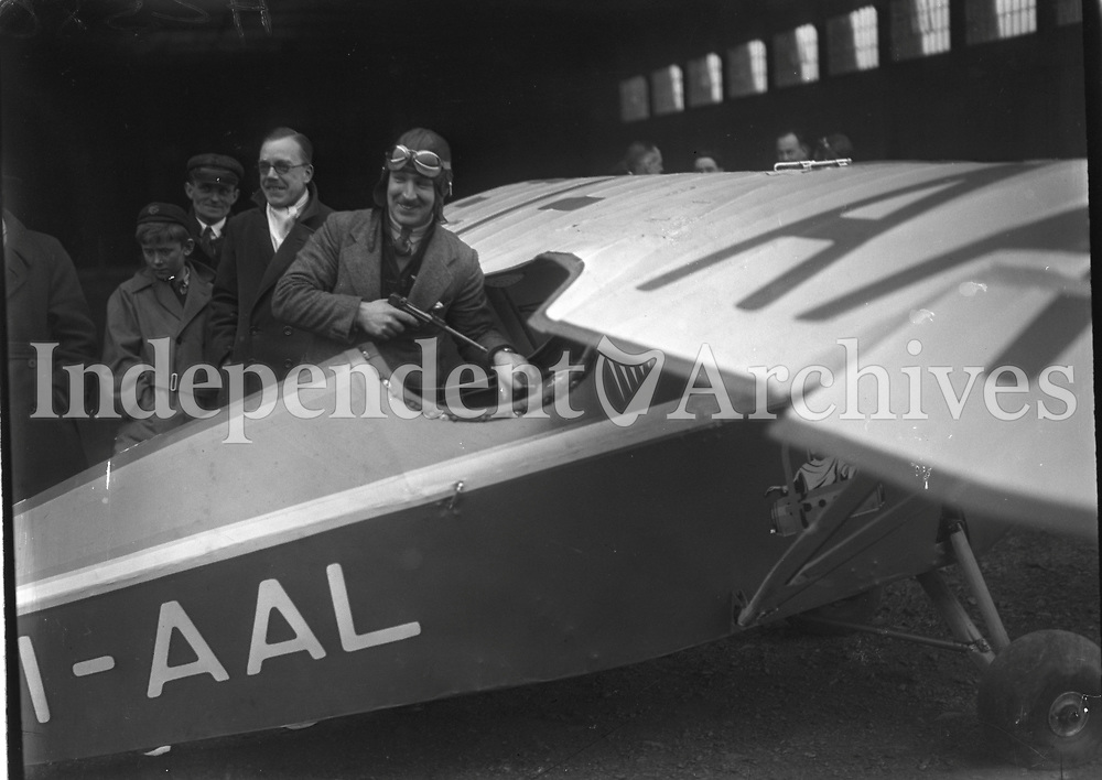 Mr Scally  Aviator at the Aircraft &quot;Shamrocket&quot; with a group of people around it. Mr.Scally placing his revolver in the cockpit before starting his flight to Ceylon<br /> 18 February 1932.<br /> (Part of the Independent Newspapers Ireland/NLI Collection)
