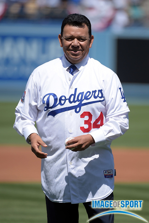 Apr 6, 2015; Los Angeles, CA, USA; Fernando Valenzuela throws out the ceremonial first pitch before the 2015 MLB opening day game between the San Diego Padres and the Los Angeles Dodgers at Dodger Stadium.