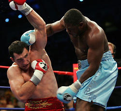 Wladimir Klitschko (l) and Samuel Peter (r) trade punches during their fight Saturday night at Boardwalk Hall in Atlantic City, NJ.  Klitschko won via 12 round unanimous decision.