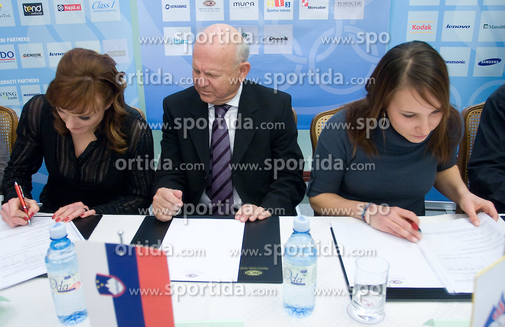 Petra Majdic, Janez Kocijancic of OKS and Mateja Robnik at press conference when they have signed a contract with IOC and OKS for 16 months long sponsorship (1500 $ monthly) till Olympic games in Vancouver 2010, on December 22, 2008, Grand hotel Union, Ljubljana, Slovenia. (Photo by Vid Ponikvar / SportIda).
