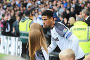 Derby County defender Curtis Davies (33) leads out the Derby team during the EFL Sky Bet Championship match between Derby County and Birmingham City at the Pride Park, Derby, England on 28 September 2019.