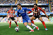 Chelsea Midfielder Eden Hazard (10) keeps the ball from Sunderland Defender Joleon Lescott (15) during the Premier League match between Chelsea and Sunderland at Stamford Bridge, London, England on 21 May 2017. Photo by Andy Walter.