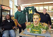 2014 draft prospect Anthony Barr, center, Tony Pace, right, CMO, SUBWAY, and Eric LeGrand, SUBWAY Famous Fan, celebrate Barr's induction as the newest Famous Fan by unveiling a life-size food statue made of fresh vegetables, Wednesday, May 7, 2014, in New York. Barr joins a roster of fellow Famous Fans that include Robert Griffin III, Justin Tuck, Russell Westbrook, Pele and Michael Phelps. (Photo by Diane Bondareff/Invision for SUBWAY/AP Images)