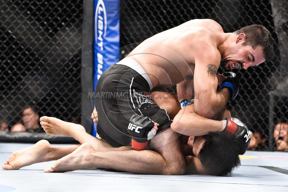 "ATLANTA, GEORGIA, SEPTEMBER 6, 2008: Matt Brown (top) has an elbow strike blocked by Dong Hyun Kim during ""UFC 88: Breakthrough"" inside Philips Arena in Atlanta, Georgia on September 6, 2008"