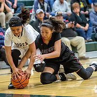 Thoreau Hawk Valentina Delgarito (14), left, and Shiprock Chieftain Aiona Johnson (20) dive for a loose ball on the baseline at Thoreau High School Friday.