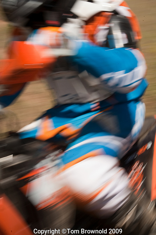 MX rider in a blur of speed