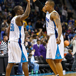 January 17, 2011; New Orleans, LA, USA;  New Orleans Hornets power forward David West (30) celebrates with center Emeka Okafor (50) following a win over the Toronto Raptors at the New Orleans Arena. The Hornets defeated the Raptors 85-81.  Mandatory Credit: Derick E. Hingle