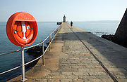 Red life saving ring on harbour breakwater, St Peter Port, Guernsey, Channel Islands, UK