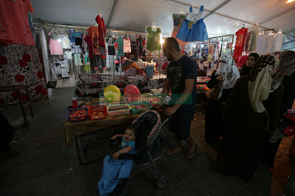 June 14, 2018 - Algiers, Algeria - Local people shop at an open-air market ahead of the Eid al-Fitr festival in Algiers, the capital of Algeria, on June 14, 2018  (Credit Image: © Billal Bensalem/NurPhoto via ZUMA Press)