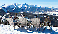 Skiers break for a beer at the top of lift nine at the Telluride Ski Resort.