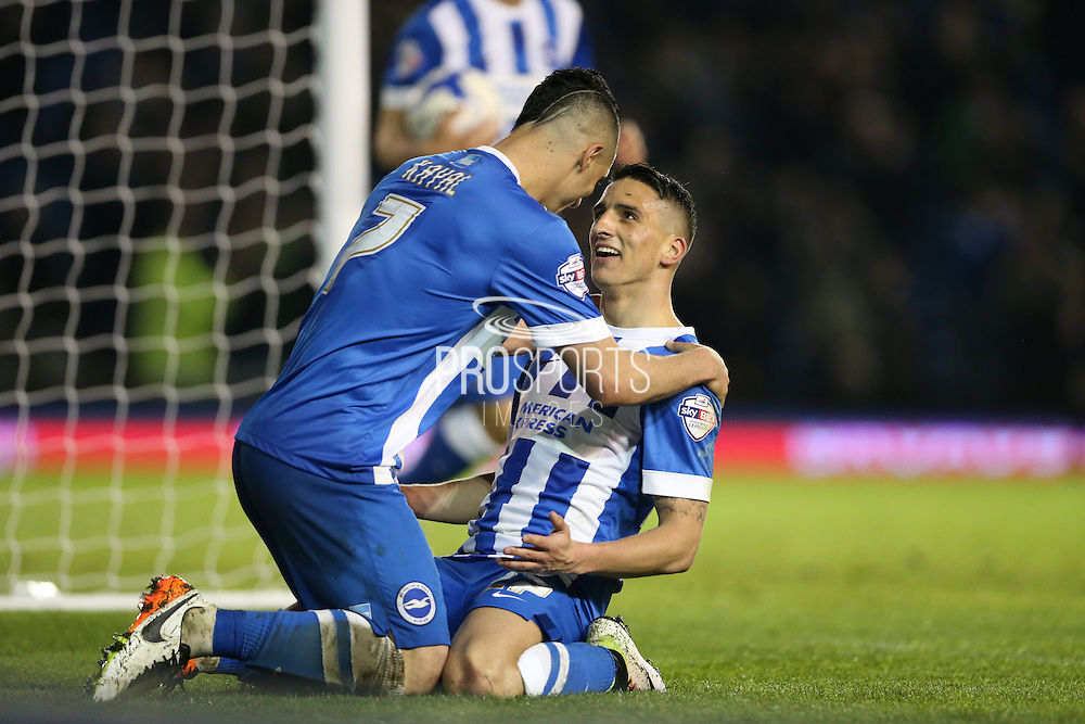Brighton central midfielder, Beram Kayal (7) congratulates Brighton striker, Anthony Knockaert (27) for his goal during the Sky Bet Championship match between Brighton and Hove Albion and Fulham at the American Express Community Stadium, Brighton and Hove, England on 15 April 2016.