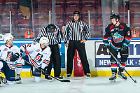 KELOWNA, CANADA - SEPTEMBER 22: Kobe Mohr #42 of the Kamloops Blazers kneels on the ice during warm up speaking to linesman against Mark Liwiski #9 the Kelowna Rockets on September 22, 2018 at Prospera Place in Kelowna, British Columbia, Canada.  (Photo by Marissa Baecker/Shoot the Breeze)  *** Local Caption ***