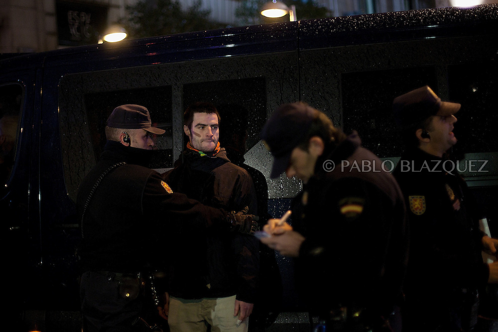 Riot police detain a protestor during a demonstration against political corruption and claiming Mariano Rajoy to resign in Madrid on February 1, 2013. The Spanish Newspaper 'El Pais' published secret papers of income implicating Spanish Prime Minister and other members of the PP (Popular Party). Rajoy's government has denied these secret payments.