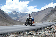 India, Manali, Kullu District, Himachal Pradesh, Northern India a tourist motorbike rider on route from Manali to Leh