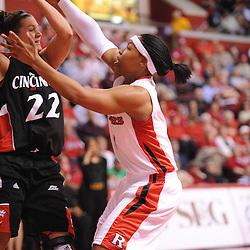 Feb 24, 2009; Piscataway, NJ, USA; Rutgers guard Khadijah Rushdan (1) defends Cincinnati forward Shelly Bellman (22) on a full court press during the second half of Rutgers' 71-52 victory over Cincinnati at the Louis Brown Athletic Center.