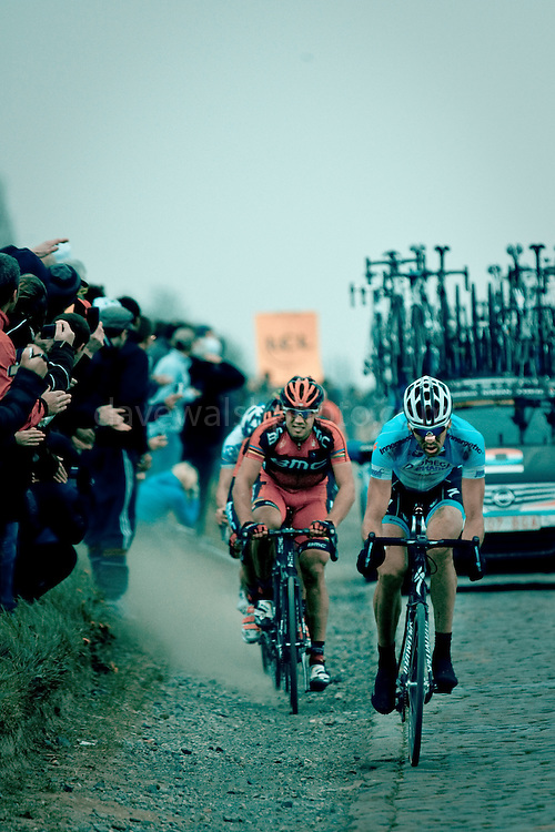 Belgian cyclist Stijn Vandenbergh leads a group, 4:37 behind his teammate and winner Tom Boonen, 13km from the finish of the 2012 Paris Roubaix professional cycling race classic. Here, Vandenbergh is passing Gruson, the 3rd last section of cobbles, 243km into the 256.5km route from Compiègne, near Paris, to Roubaix, northern France, which crosses 51.5km of pavé - 27 sections of ancient cobblestones, along the way. Vandenbergh placed 24th, out of 86 finishers out of 196 starters.