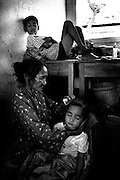Refugees take shelter near UNIMET headquarters in fear of Militia attack, Dili East Timor August 1999<br /> <br /> &copy;David Dare Parker/AsiaWorks Photography