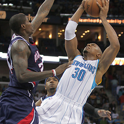 05 November 2008:  New Orleans Hornets forward David West (30) shoots over Atlanta Hawks forward Marvin Williams (24) during a 87-79 victory by the Atlanta Hawks over the New Orleans Hornets at the New Orleans Arena in New Orleans, LA..