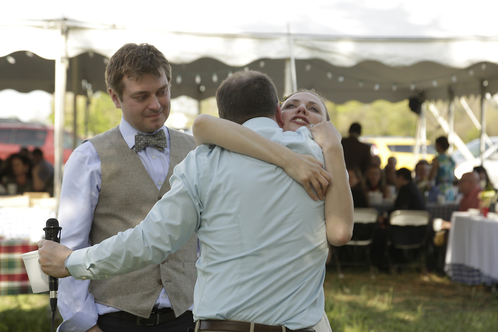 John and Elise celebrate their wedding day with family and friends in Nashville, Ill. on Saturday, May 3, 2014. (Photo by Jason Redmond)