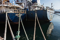 """PALERMO, ITALY - 6 JUNE 2016: (R-L) Cargo ships Munzur and Meryem, seized respectively in December 2015 with 13 tons of hashish and in June 2015 with 20 tons of hashish within the """"Operazione Libeccio"""", are docked here in the harbor of Palermo, Italy, on June 6th 2016.<br /> <br /> Between January 2014 e December 2015 more than 120 tons of hashish, carried on fishing boats or cargo ships from Morocco to Libya, were seized in the Strait of Sicily by Italy's Guardia di Finanza (Financial Police) thanks to an international police investigation named """"Operazione Libeccio"""", carried out by the GICO (Gruppo Investigativo Criminalità Organizzata, Organised Crime Investigation Group), a unit of the tax police of Palermo under the supervision of the DDA (Direzione Distrettuale Antimafia) of Palermo.<br /> <br /> """"What is happening in Libya is same historical occurrence that happened years ago in Afghanistan. Such as the Talibans who financed their terroristic activities with heroin trafficking for the purchase of weapons, the Caliphate is proposing the same terroristic strategy by purchasing and commercialising hashish in order to purchase weapons used in their war"""" Sergio Barbera, Deputy General Prosecutor of Palermo, said."""