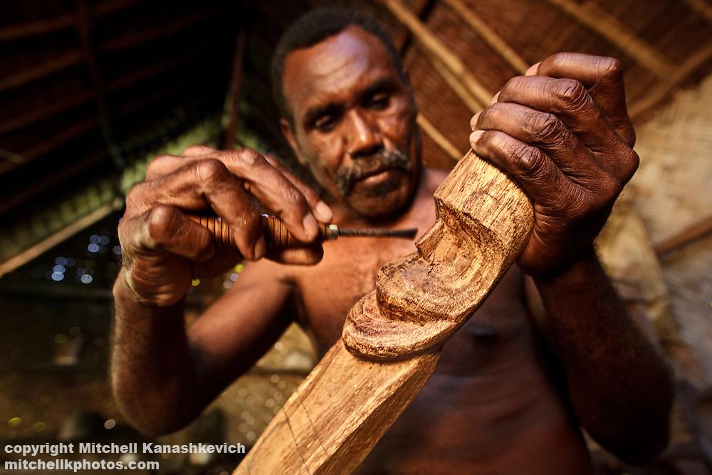 Ni Vanuatu man carving a traditional figure from wood. Mota Lava Island, Torba Province, Vanuatu