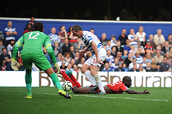 Liverpool's Mario Balotelli goes down after a challenge from Queens Park Rangers's Richard Dunne - Photo mandatory by-line: Dougie Allward/JMP - Mobile: 07966 386802 - 19/10/2014 - SPORT - football - London - Loftus Road - QPR v Liverpool - Barclays Premier League