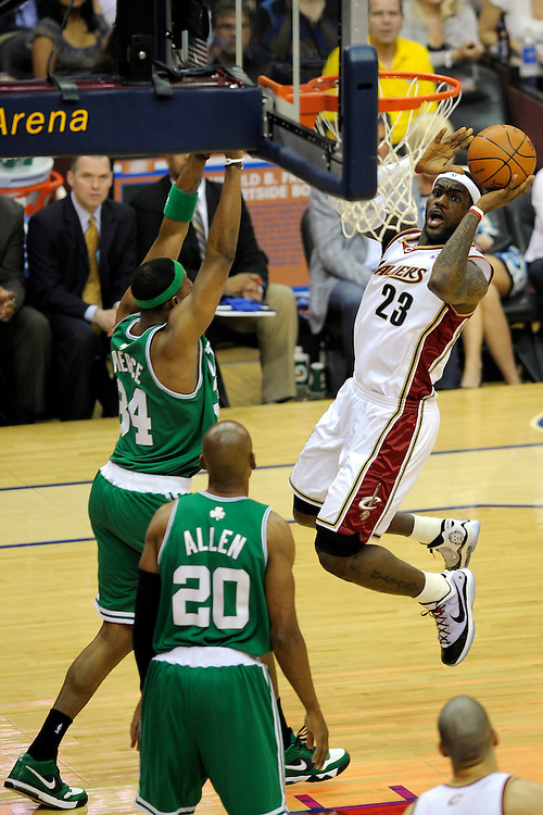May 1, 2010; Cleveland, OH, USA; Cleveland Cavaliers forward LeBron James (23) shoots over Boston Celtics forward Paul Pierce (34) and guard Ray Allen (20) during the first quarter of game one in the eastern conference semifinals in the 2010 NBA playoffs at Quicken Loans Arena. Mandatory Credit: Dave Miller-US PRESSWIRE