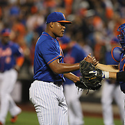 Pitcher Jeurys Familia, New York Mets, is congratulated by catcher Travis d'Arnaud after getting the final out for the win during the New York Mets Vs New York Yankees MLB regular season baseball game at Citi Field, Queens, New York. USA. 18th September 2015. Photo Tim Clayton