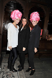 Left to right, model MARIETTA CHROUSALA, fashion designer CELIA KRITHARIOTI and model VICKY KAYA at a fashion show featuring designs from Celia Kritharioti Spring/Summer 2012 collection held at One Mayfair, London on 20th March 2012.