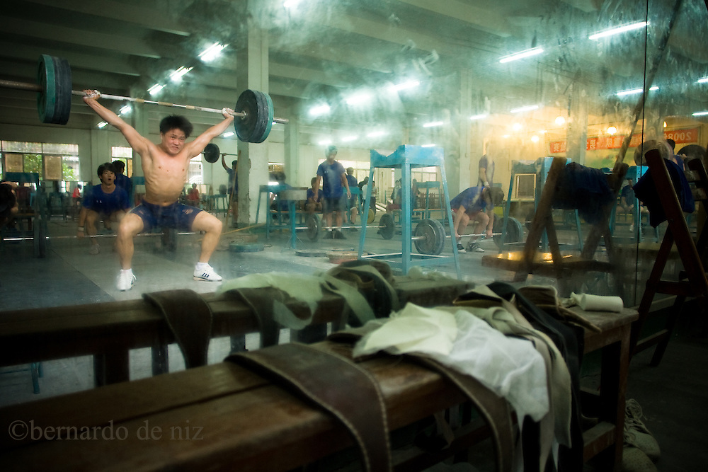 Chines weightlifting athletes train in a local gymnasium outside Beijing, China