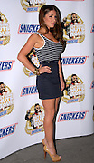 Picture by Mark Larner / Retna Pictures. Picture shows Lucy Pinder attending the Snickers Tour Party at The Arches, London. 26th February, 2009