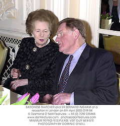 BARONESS THATCHER and SIR BERNARD INGHAM at a reception in London on 8th April 2002.	OYR 84