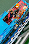Market boat selling to cruise ship, Yangtze River, China